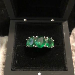 This is a5 Stone Graduating Emerald Ring, 4.55 ctw